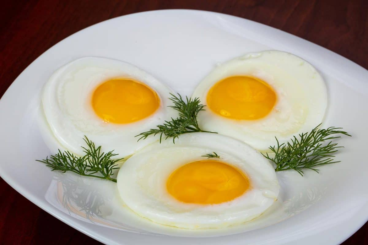 Fried eggs served with dill