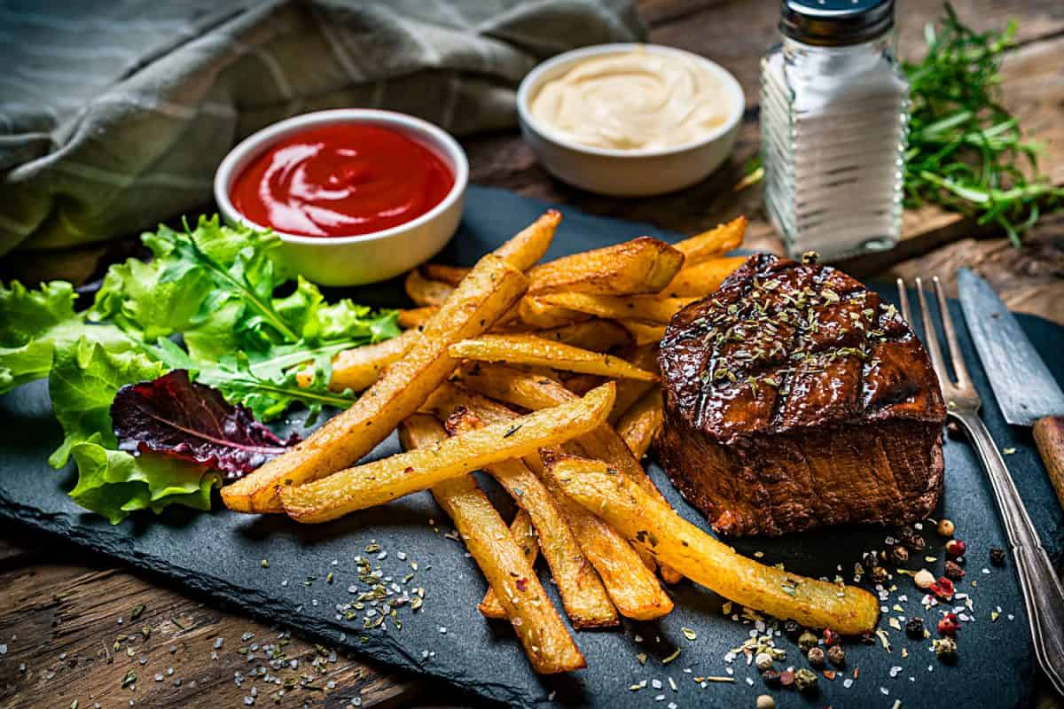 Grilled tenderloin with French fries and salad, How To Grill French Fries [Inc. 11 Must-Try Recipes]