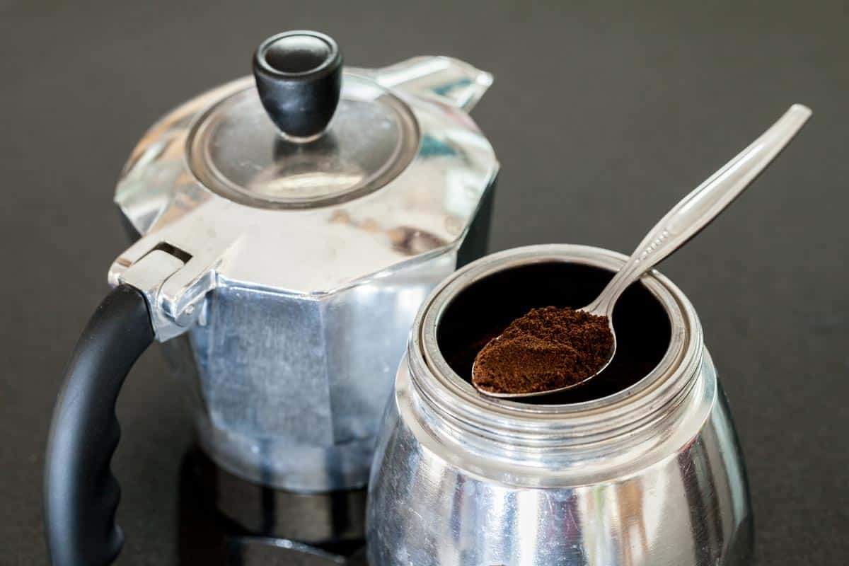 Grinded coffee on spoon in Italia coffee maker, How To Keep Coffee Grounds Out Of A Percolator
