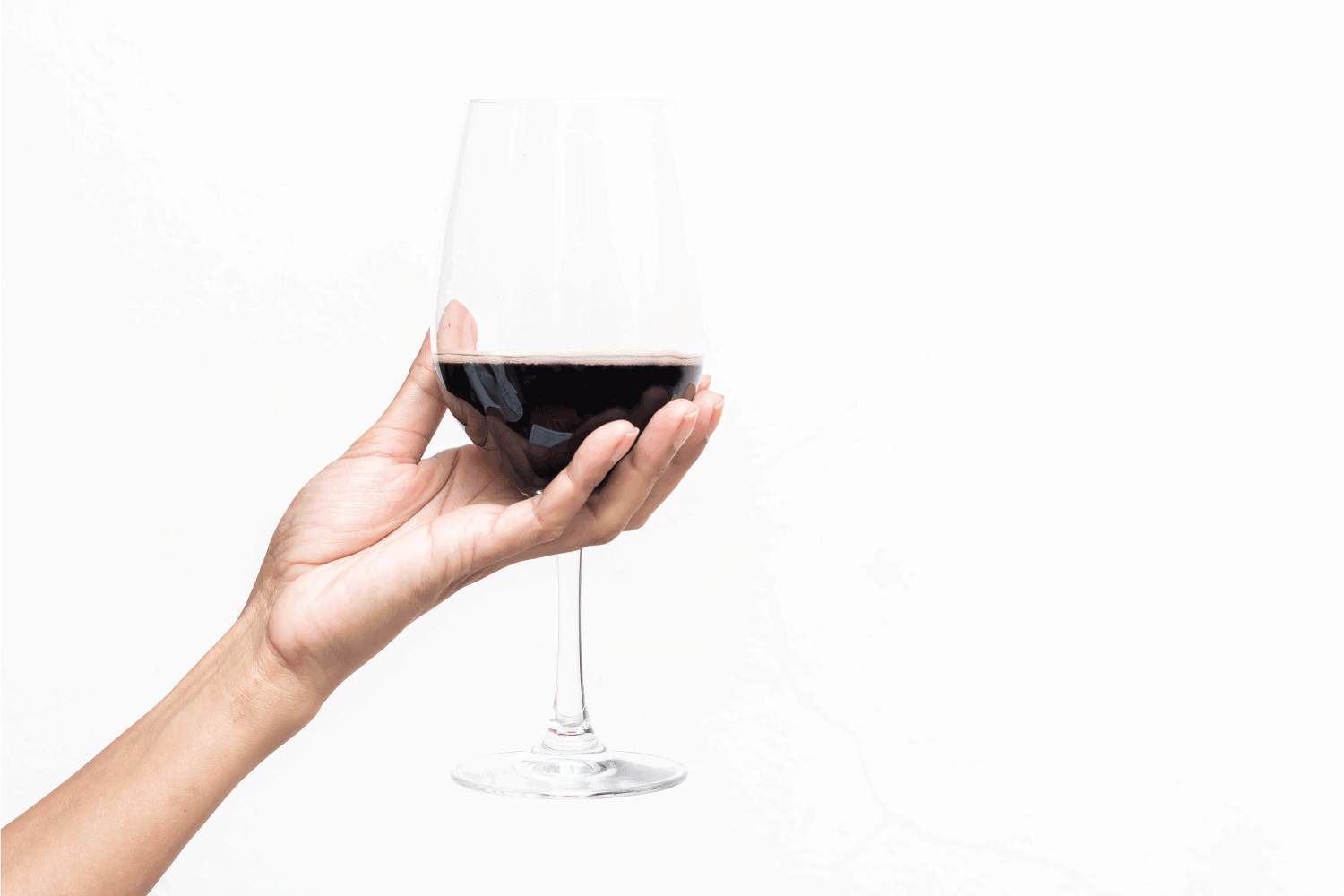 Hand holding a glass of wine