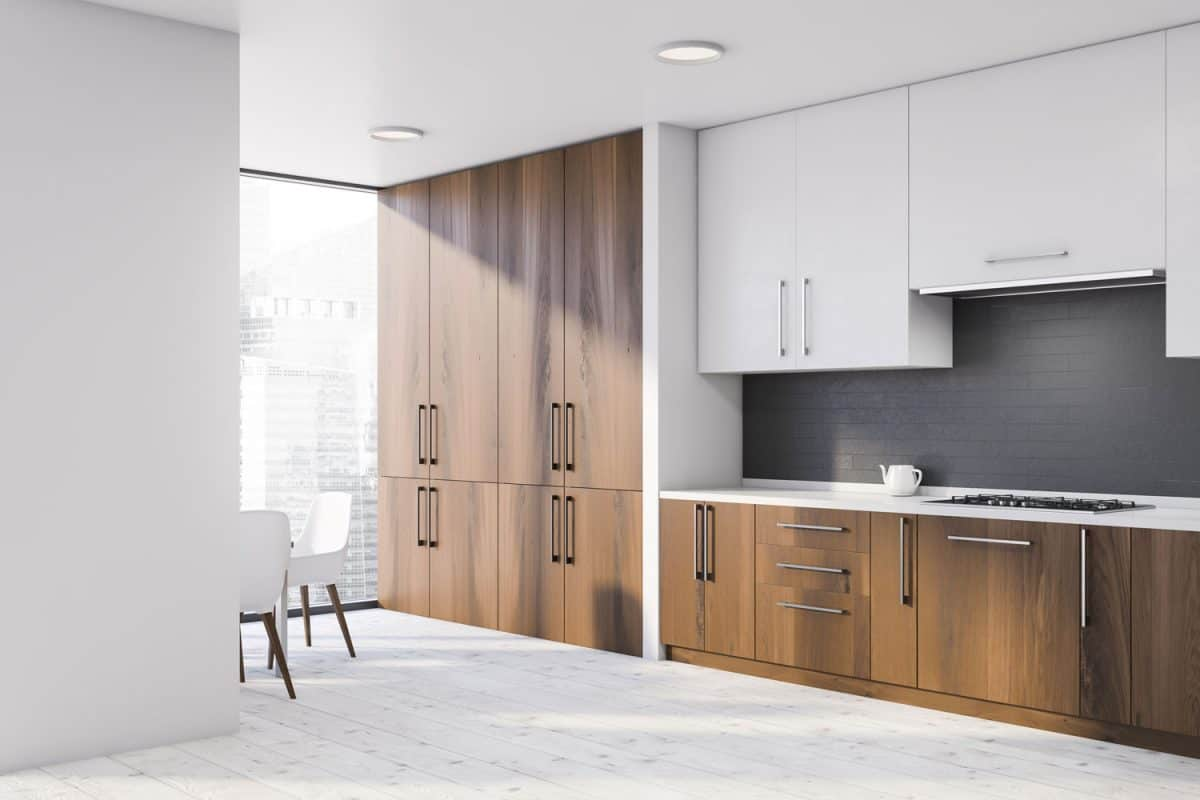 Hardwood kitchen cabinets with a white painted floating cabinet and white countertop