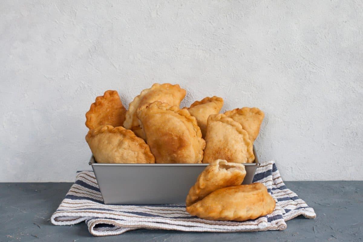 Homemade panzerotti - southern italian fried turnover. With mozzarella and mortadella filling. How To Store Empanadas Overnight