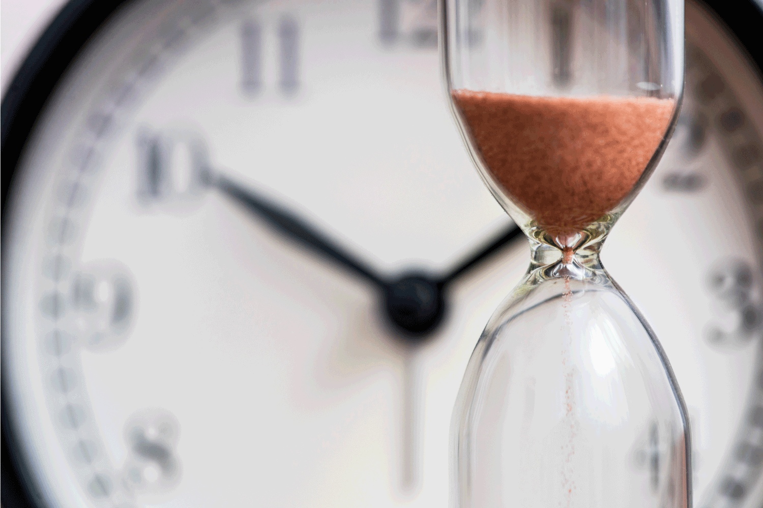Hourglass on the background of office watch as time passing concept for business deadline, urgency and running out of time. Ninja Foodi Won't Turn On - What To Do