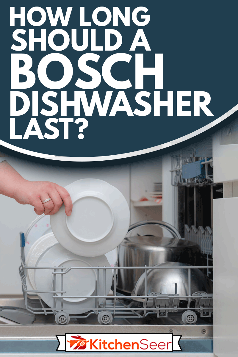 Close up of hand unloading dish washer in the kitchen, How Long Should A Bosch Dishwasher Last?