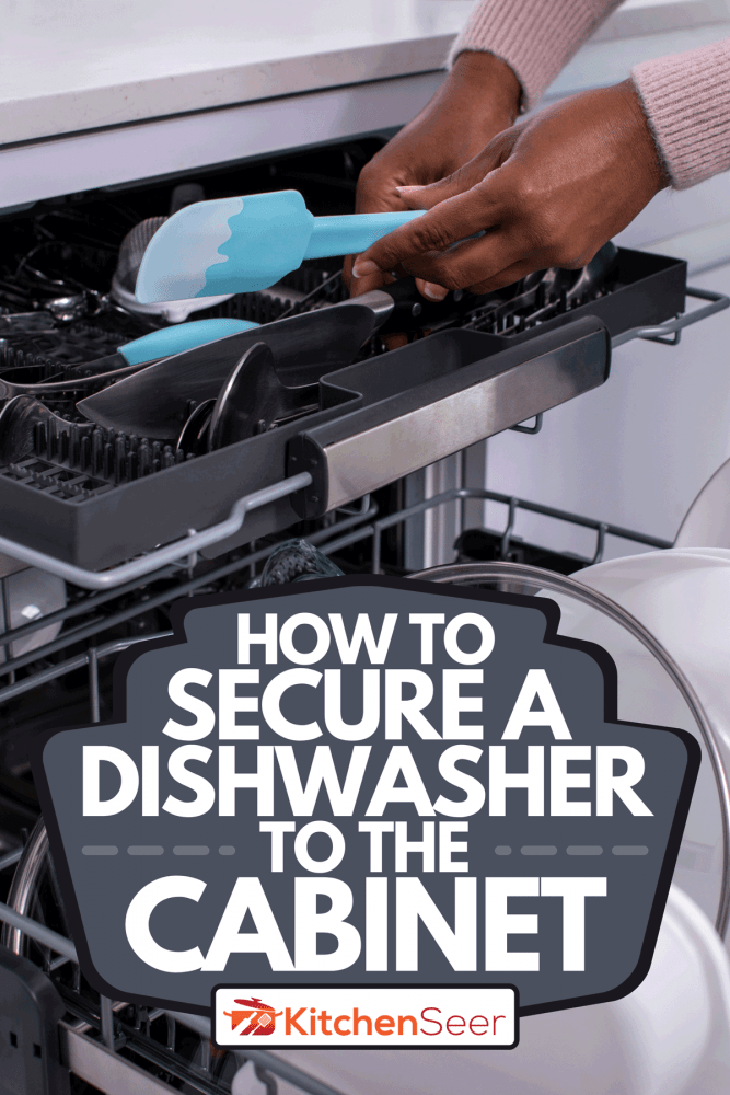 A woman unloading dishwasher after washing, How To Secure A Dishwasher To The Cabinet