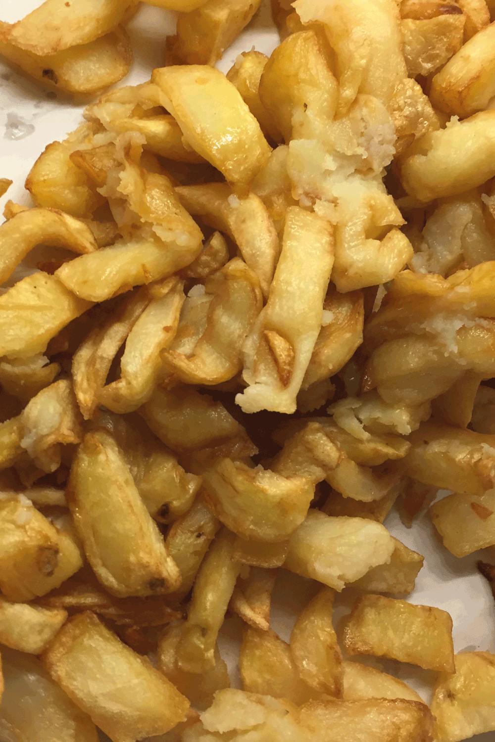 Image of soggy, floppy greasy chip shop chips. French fries takeaway food