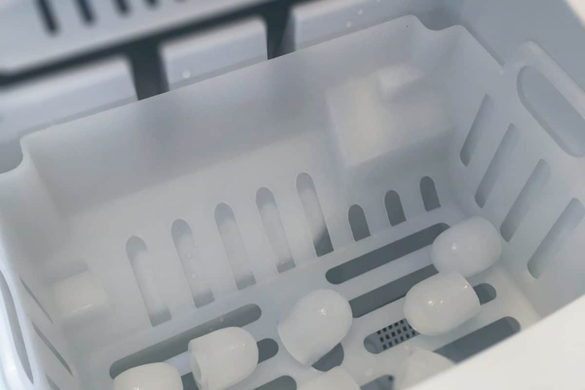 Interior of an ice maker with ice inside, Can You Add An Ice Maker To Your Fridge?