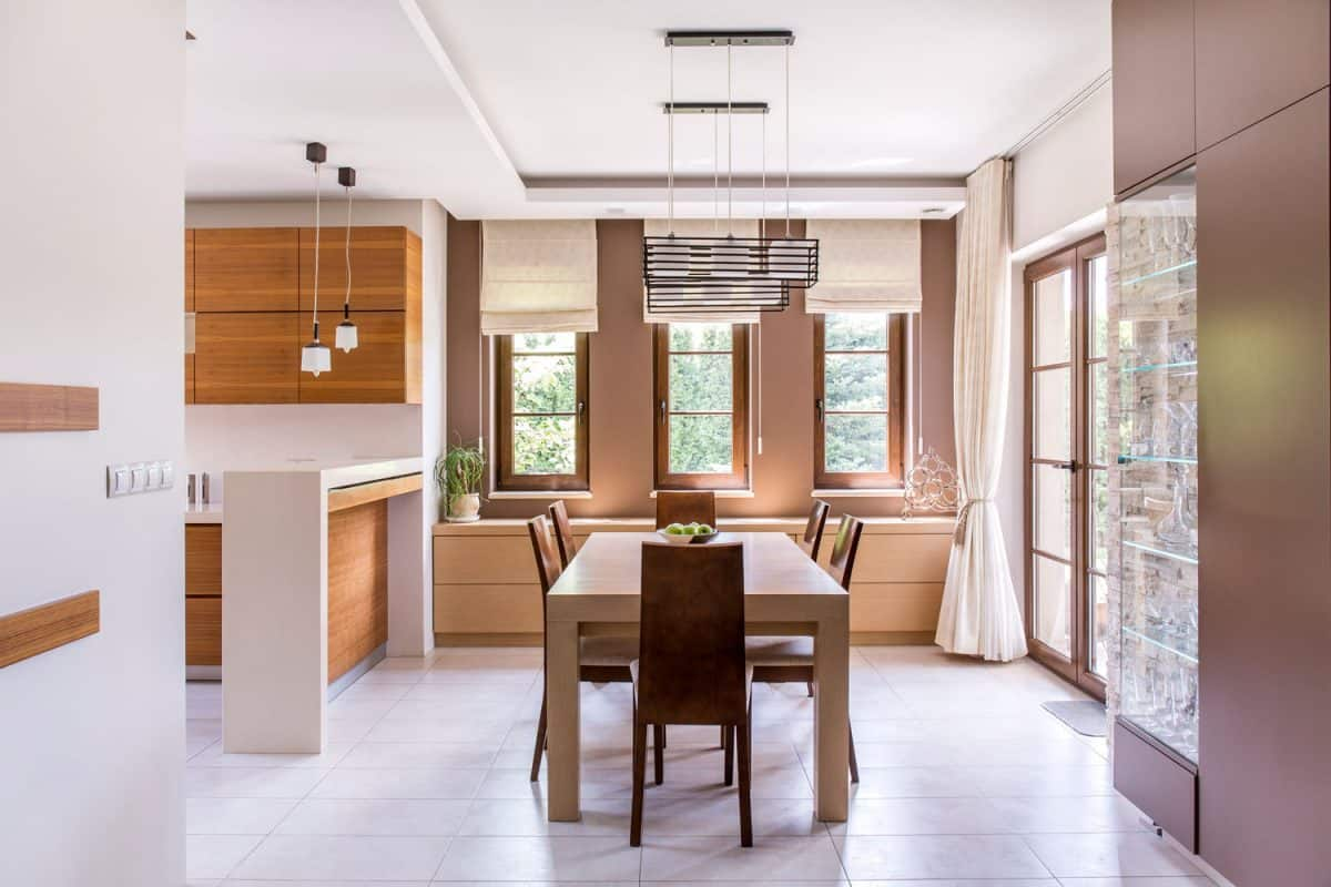 Kitchen and dining room in modern house with curtains and window blinds, Curtains VS Blinds For Kitchen Windows - Which To Choose?