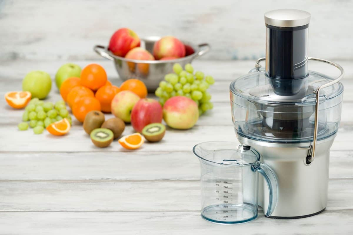 Modern electric juicer and various fruit on kitchen counter, healthy lifestyle concept, Cuisinart Food Processor Not Working - What To Do?