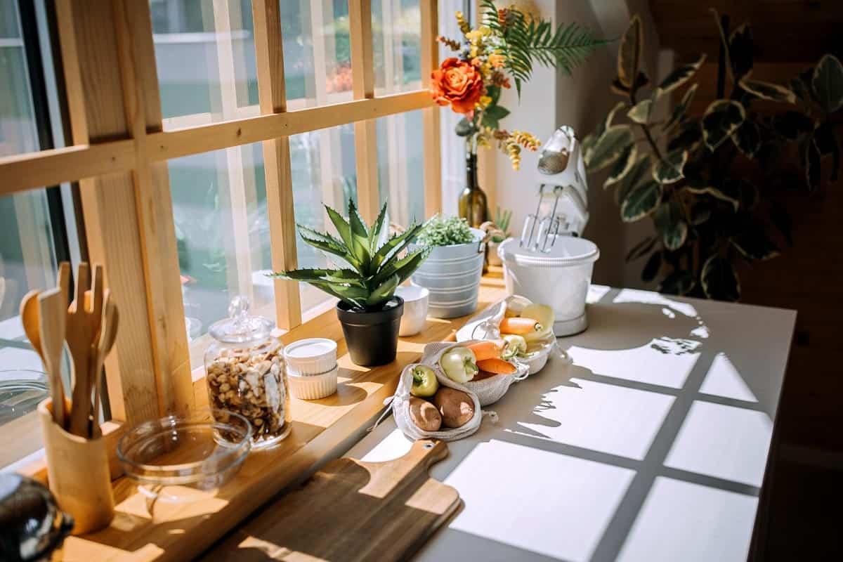 Modern kitchen table with fresh vegetables, 17 Fantastic Kitchen Windows Decor Ideas