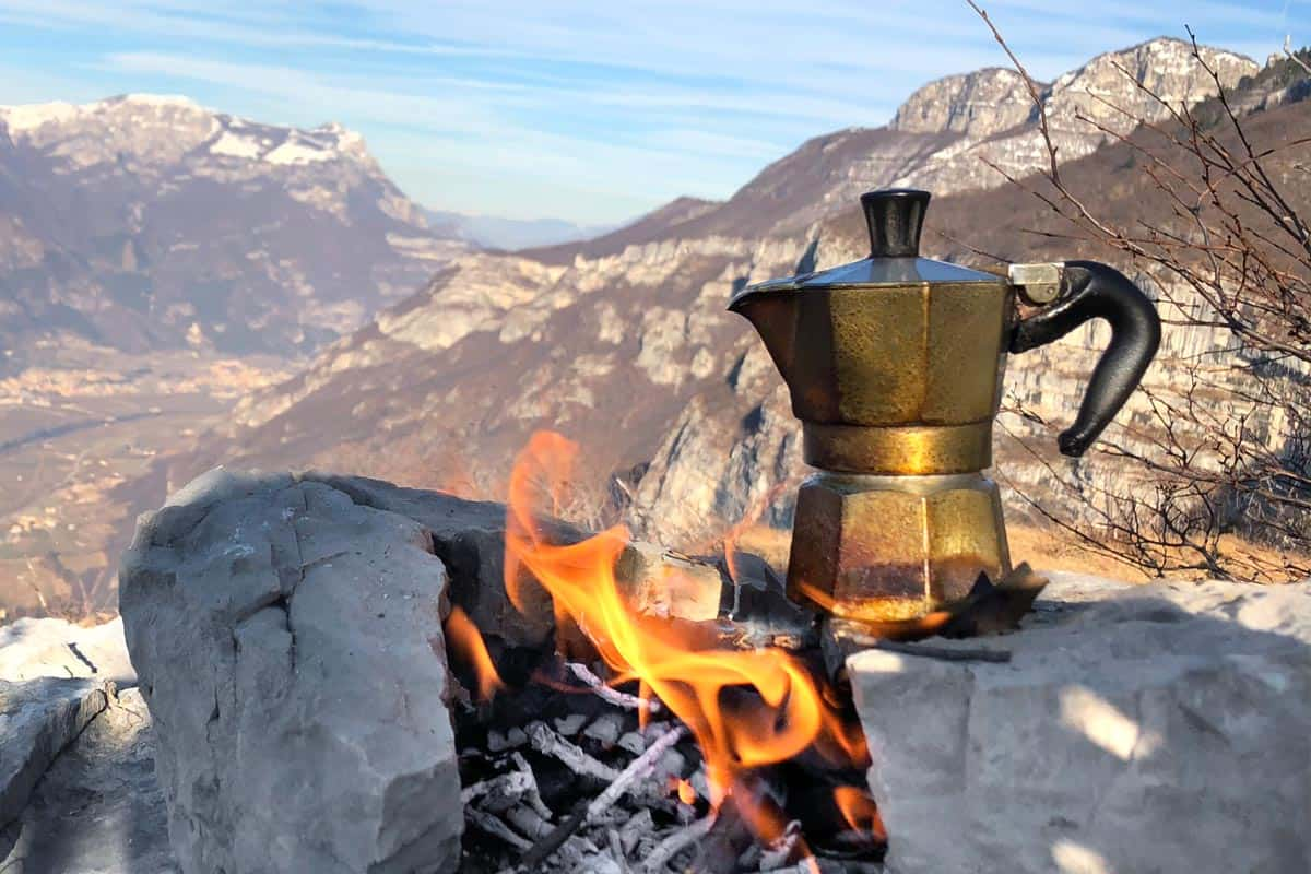 Moka on the fire in winter mountains panorama, How To Use A Campfire Coffee Percolator