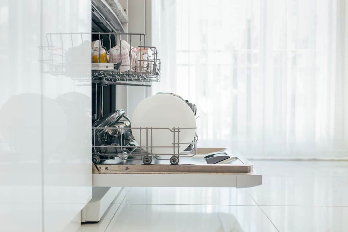 Opened dishwasher with clean dishes, Does A Bosch Dishwasher Need Hot Water?
