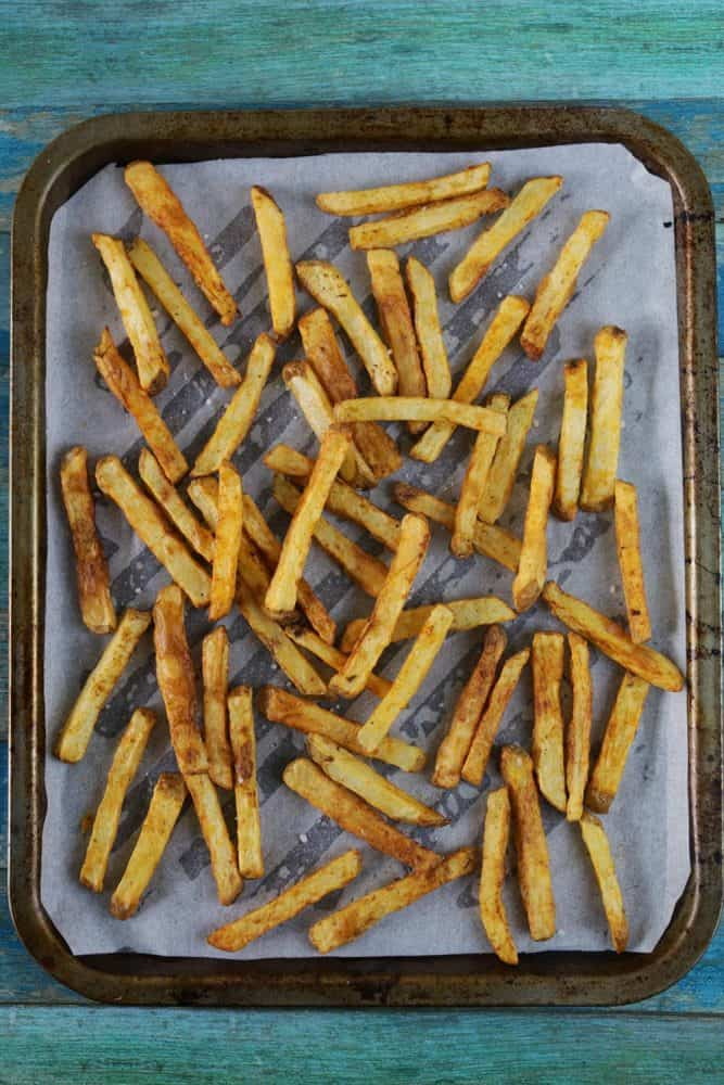 Pile of chips on baking tray lined with greaseproof paper
