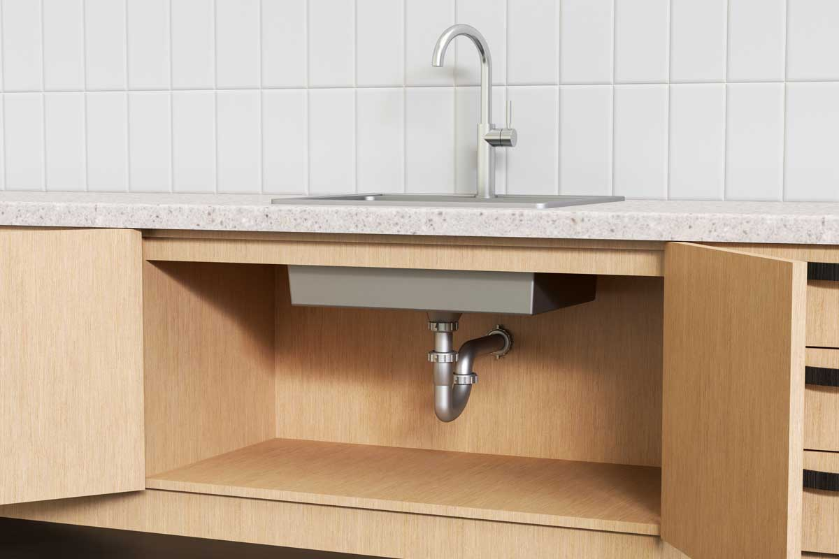Plumbing system under a modern kitchen sink, How High Should Kitchen Sink Drain Be From Floor?