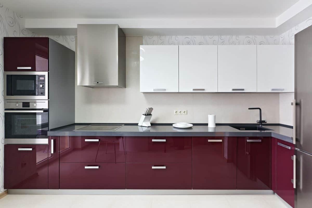Purple stainless steel kitchen cabinets inside a luxurious kitchen
