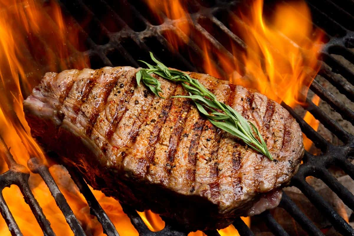 Ribeye steak on grill with fire, How Hot Should A Grill Be For Steak?