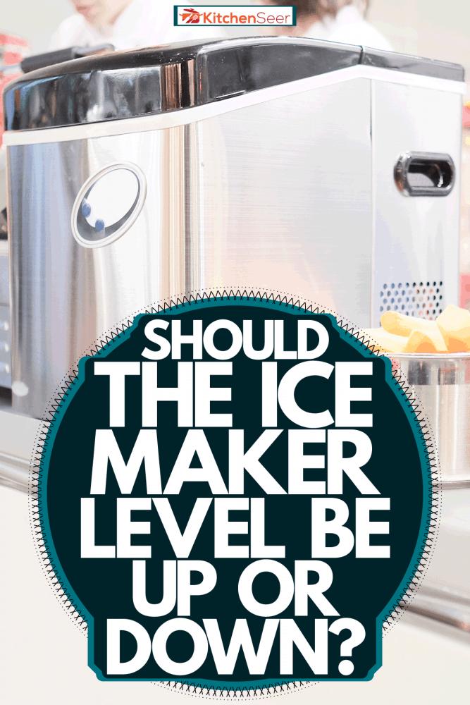 An ice maker container leveled on top of the table, Should The Ice Maker Lever Be Up Or Down?