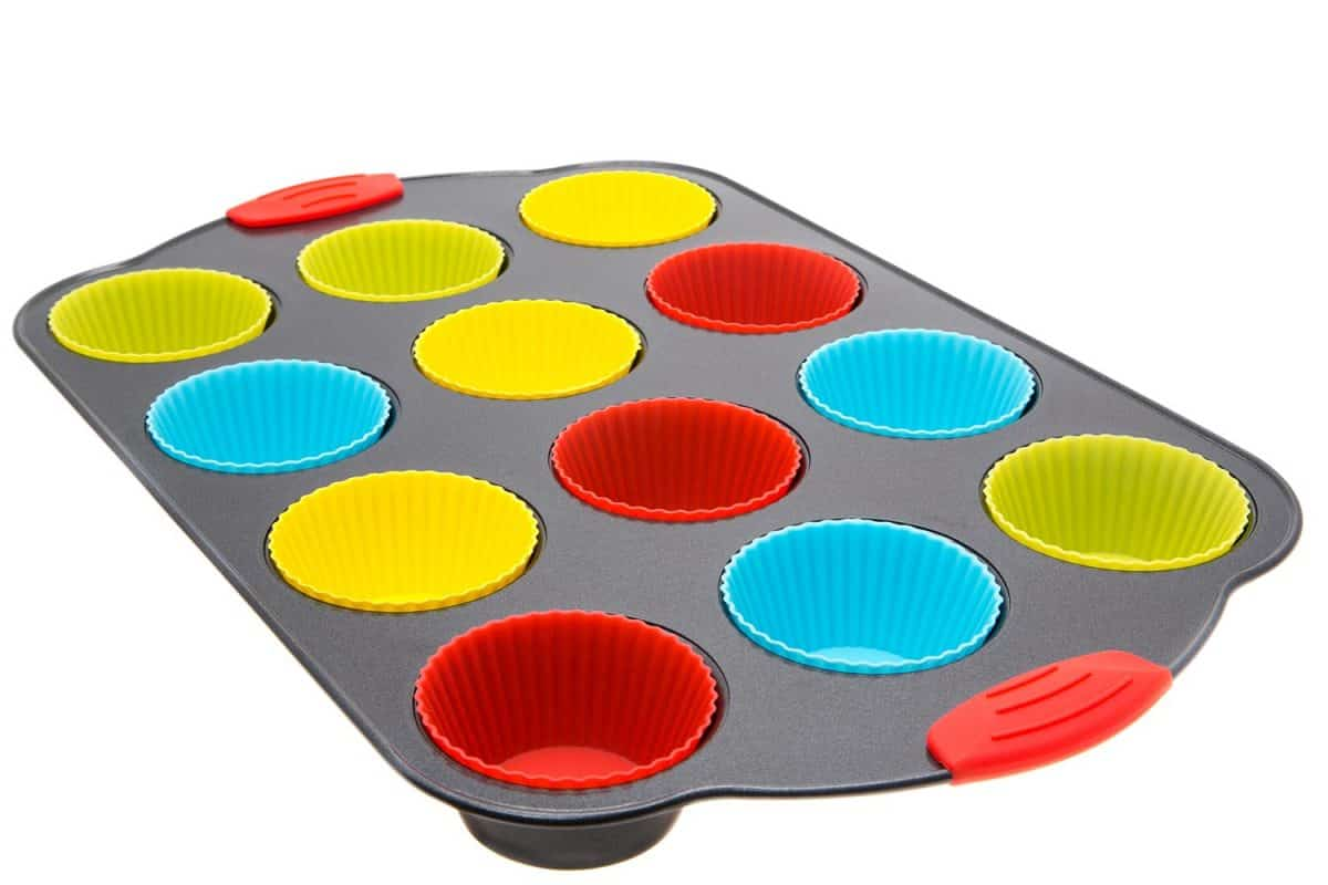 Silicone muffin moulds in a non-stick baking tray