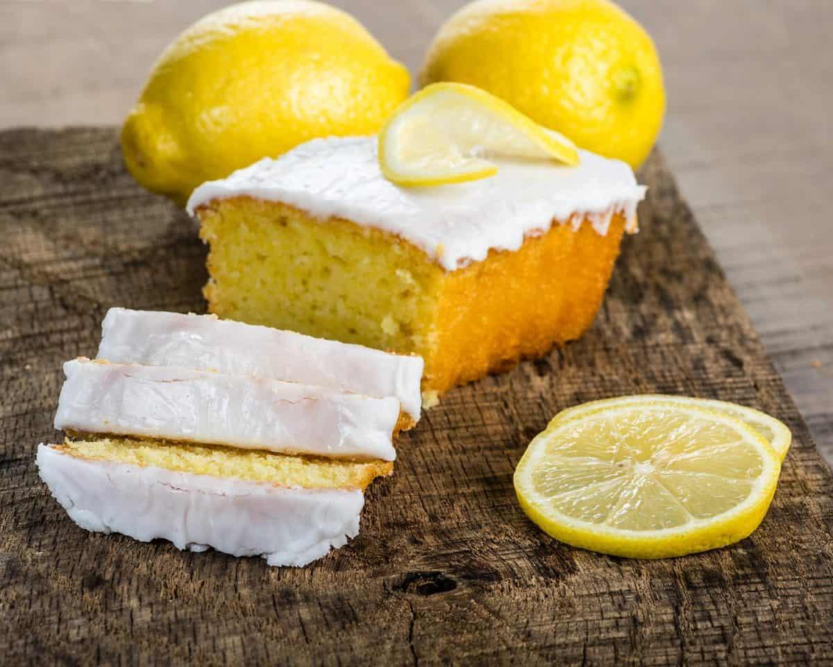 Sliced lemon pound cake with white icing