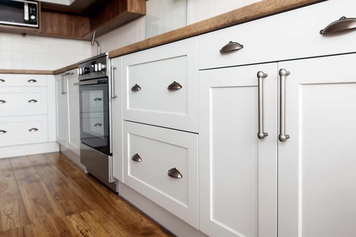 Stylish light gray handles on cabinets, Do Kitchen Cabinets Need Handles? [Inc. Handleless Options]