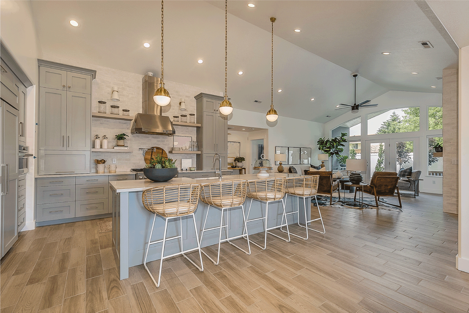 Vaulted ceiling allow pendant lights give huge open feel to custom kitchen