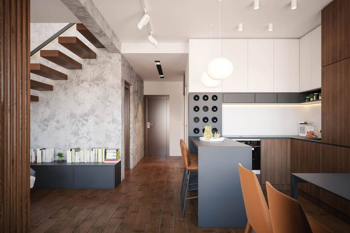 Vinyl plank flooring inside a luxurious modern kitchen with wooden cabinets and gray tables
