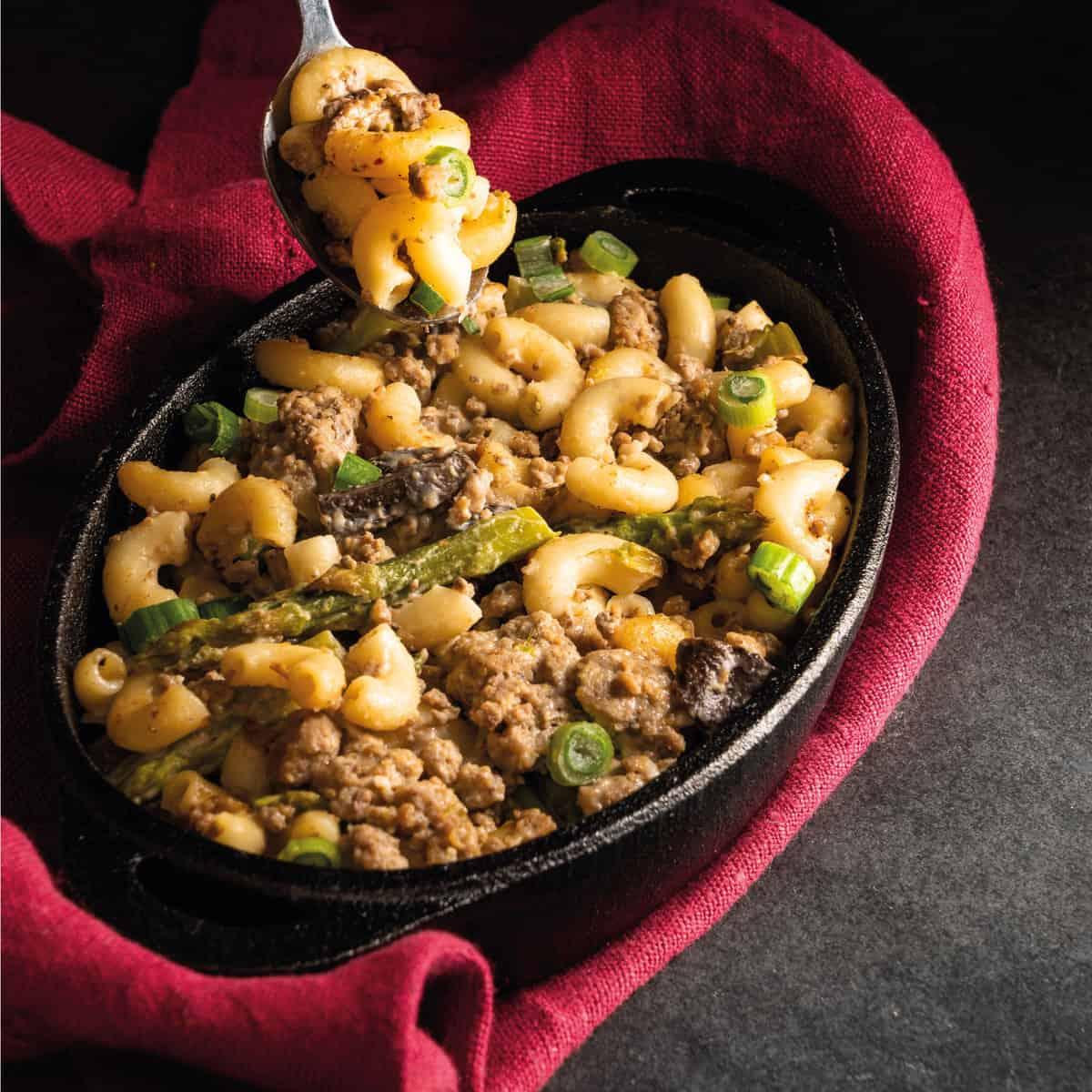 macaroni and cheese enhanced with hamburger, asparagus, and mushrooms
