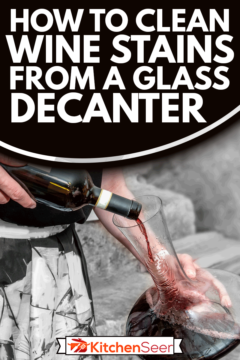 The sommelier pours wine into a glass decanter, How To Clean Wine Stains From A Glass Decanter