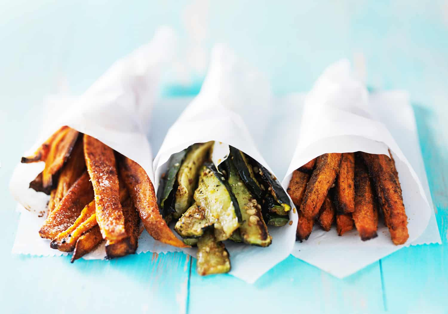 trio of carrot, zucchini, and sweet potato fries shot head on