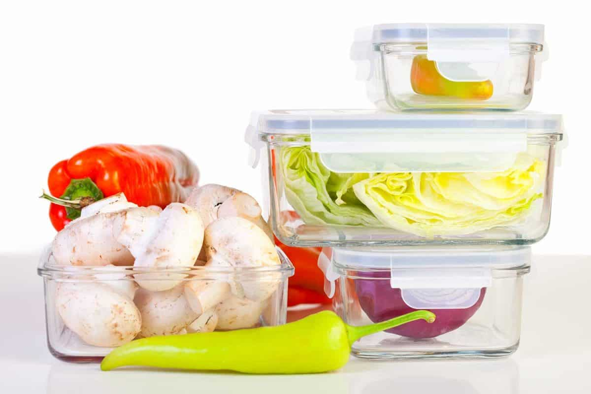 A variety of vegetables in reusable glass containers