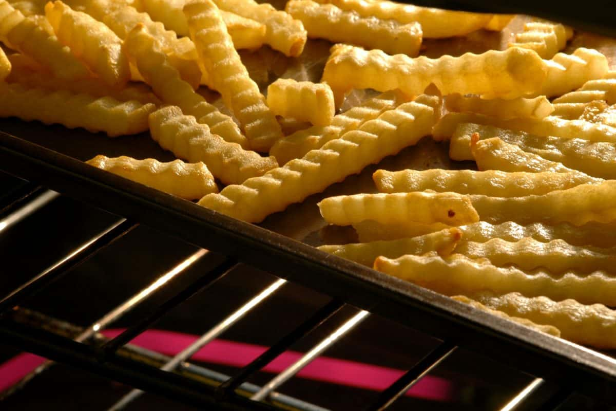 Crisscross cut french fries on the fryer