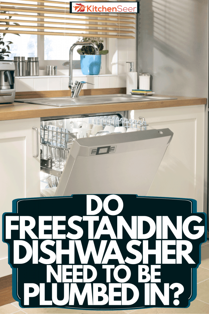 An opened dishwasher with lots of cups and other kitchen utensils, Do Freestanding Dishwashers Need To Be Plumbed In?