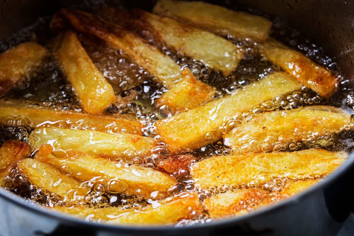 Frying French fries photographed up close