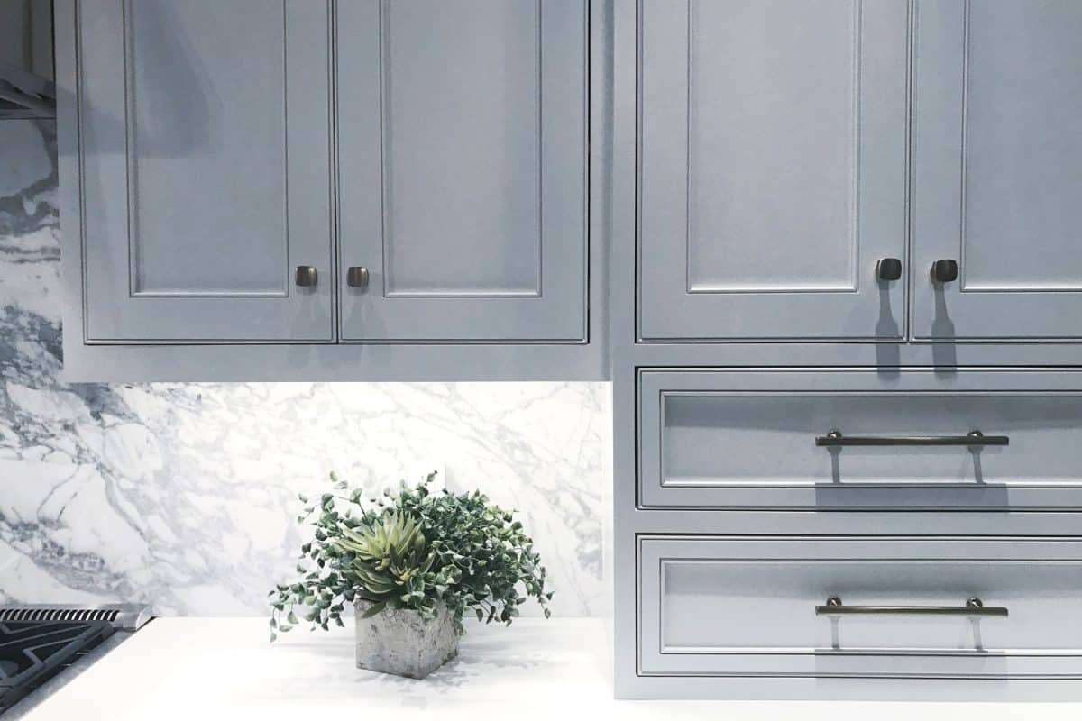 Gorgeous gray cabinets with silver knobs and handles