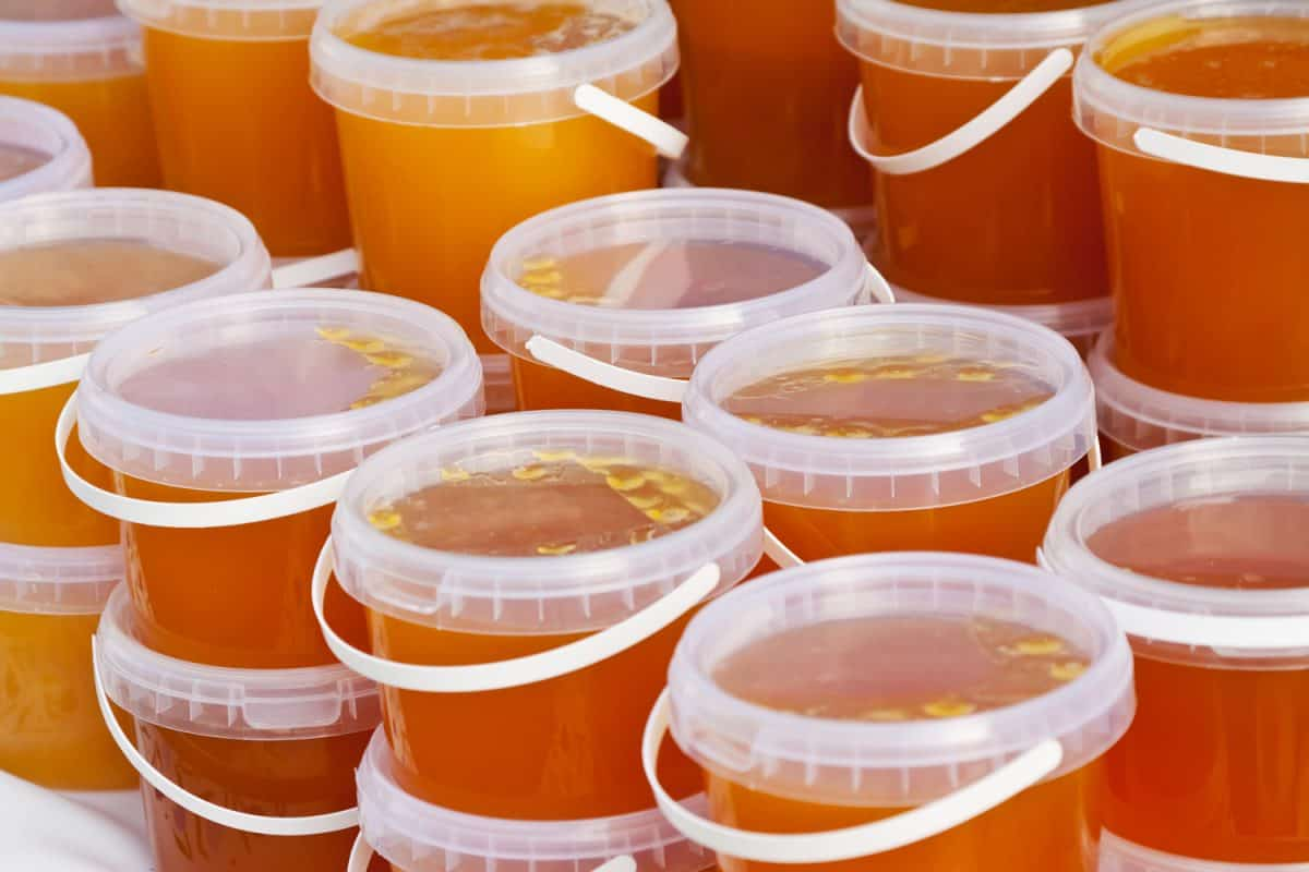 Honey stored on plastic containers