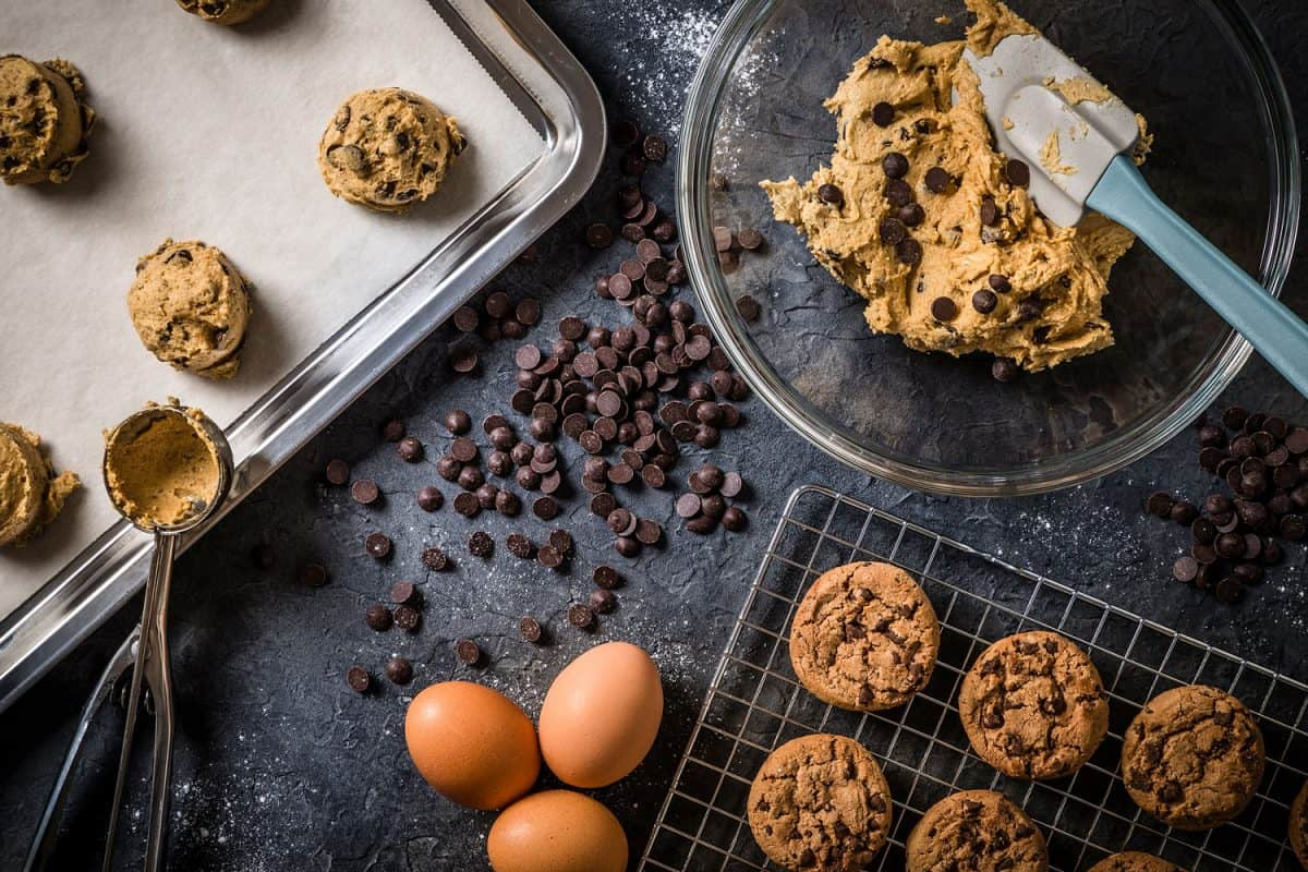 Making delicious chocolate chip cookies with ingredients on the sides