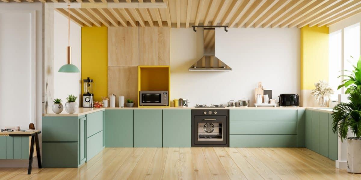 Modern kitchen interior with furniture.Stylish kitchen interior with yellow wall.