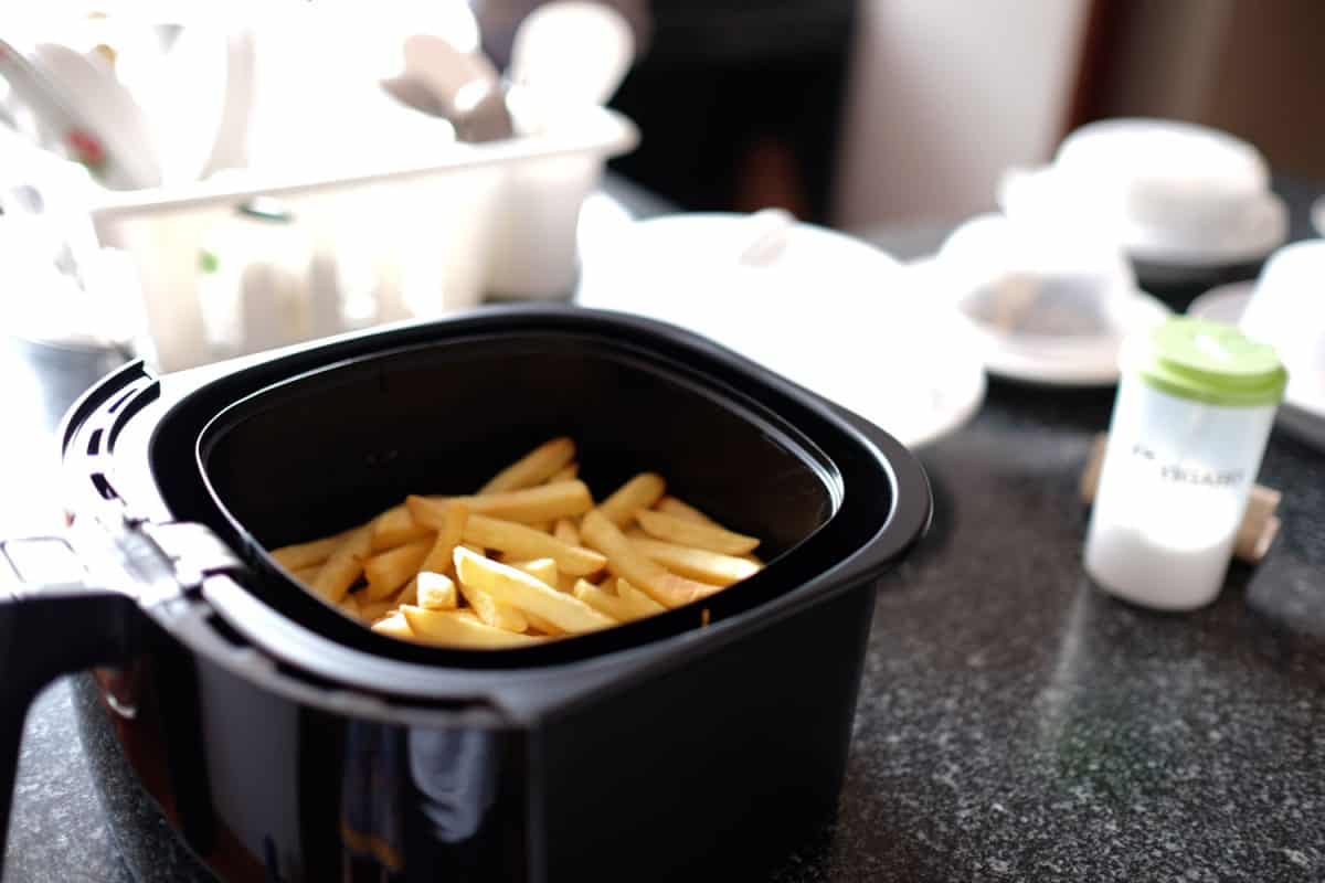 Newly cooked French fries inside an air fryer