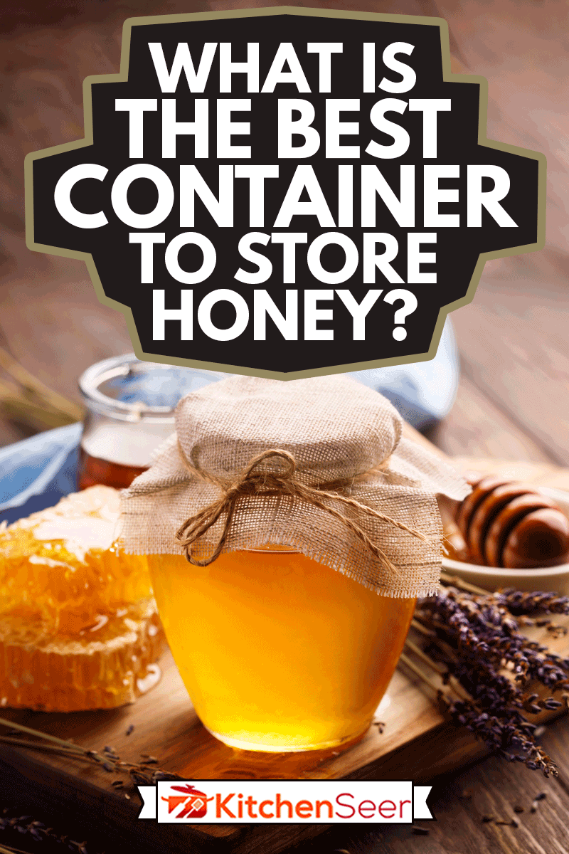 Jar of liquid honey with honeycomb inside and bunch of dry lavender over old wooden table, What Is The Best Container To Store Honey?