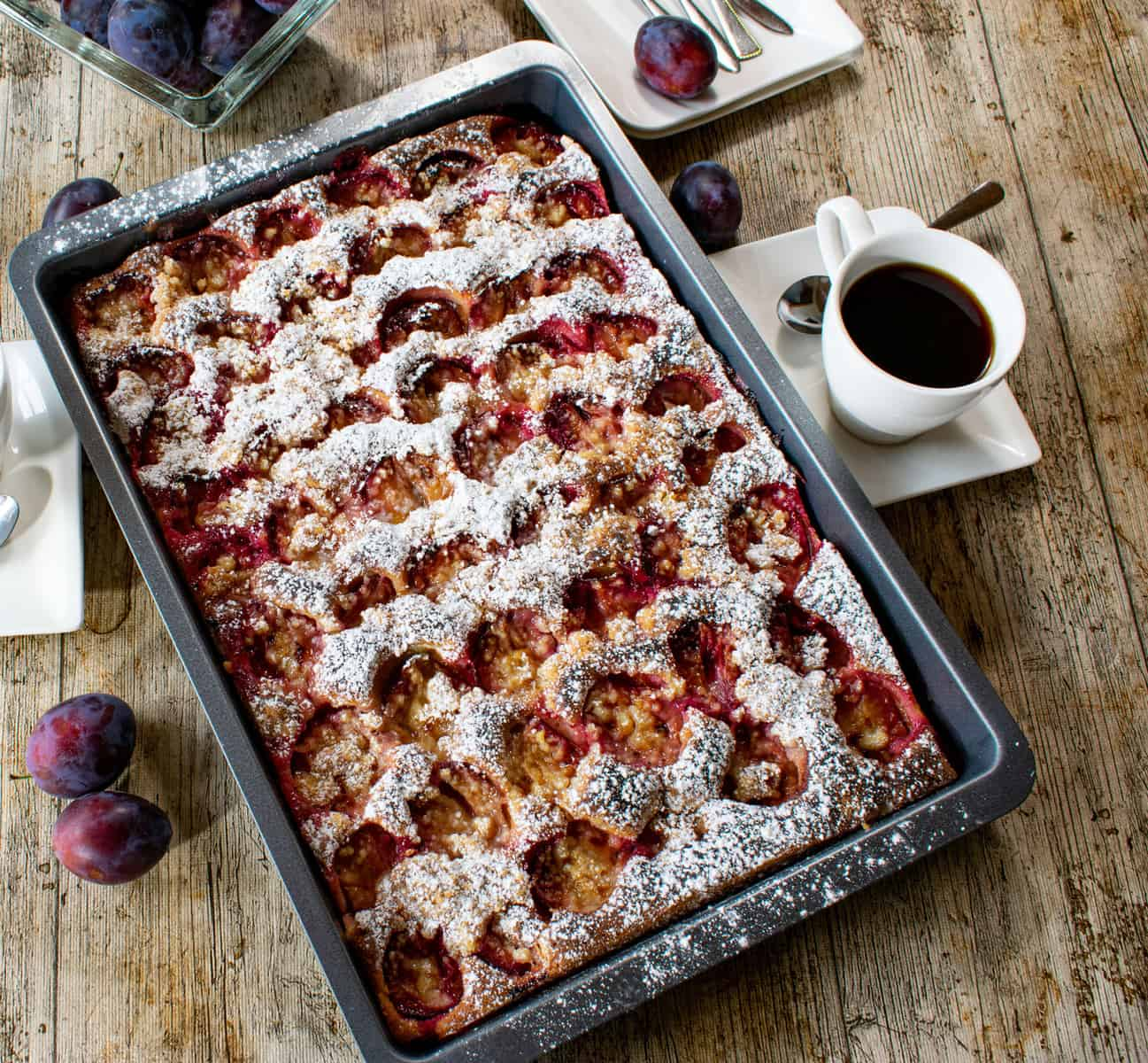 homemade german plum crumble cake on a baking sheet - warm and ready to eat