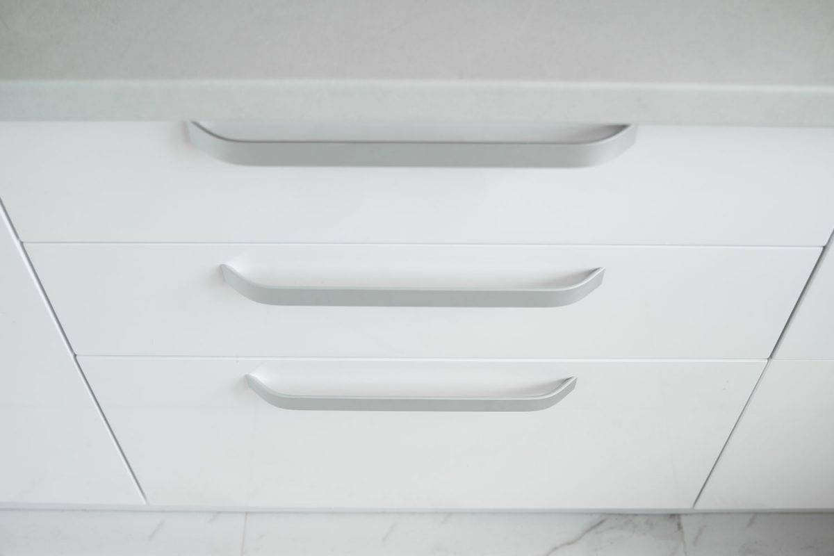 White kitchen cabinet with stainless steel handles